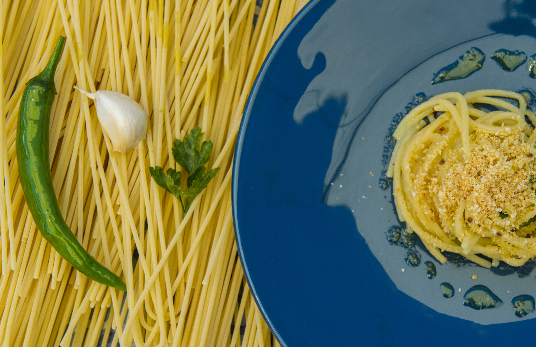 signum Spaghetti Aglio, Olio, e Peperoncino in Guazzetto di Mare e Prezzemolo